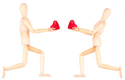 Wooden Dummy holding red heart. Isolated. Health insurance or love concept Stock Image