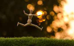 Wooden dummy jumping Stock Photography