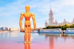 Wooden dummy, mannequin or man figurine stand stock photos