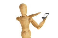 Wooden dummy with mobile smartphone Royalty Free Stock Image