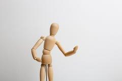 Wooden dummy posing Royalty Free Stock Image