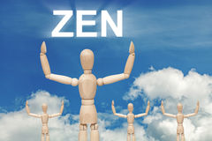 Wooden dummy puppet on sky background with text ZEN stock photos