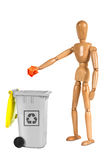 Wooden dummy putting paper in container Royalty Free Stock Images