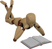 Wooden dummy reading book Stock Photo