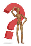 Wooden dummy with a red question mark Stock Images