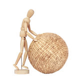 Wooden dummy rolls ball Stock Photos