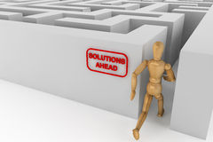 Wooden dummy runing to solution in labyrinth Stock Images