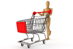 Wooden dummy with Shopping Cart Stock Photo
