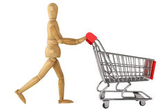 Wooden dummy with Shopping Cart Royalty Free Stock Image