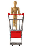 Wooden dummy with Shopping Cart Royalty Free Stock Photos