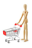 Wooden dummy with shopping cart on white background Royalty Free Stock Photography