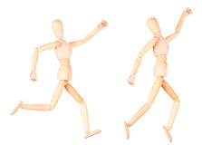 Wooden Dummy sprinter running isolated. Over White Background Royalty Free Stock Image