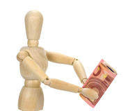 Wooden dummy and ten euros! Royalty Free Stock Photos