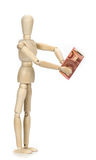 Wooden dummy and ten euros Royalty Free Stock Images