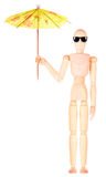Wooden Dummy with an umbrella and sun glasses Stock Image