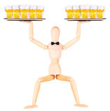 Wooden Dummy waiter with beer on tray Royalty Free Stock Images
