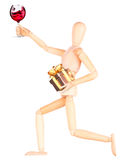 Wooden Dummy with wine holding gift Royalty Free Stock Photos