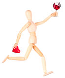 Wooden Dummy with wine holding red heart Royalty Free Stock Images
