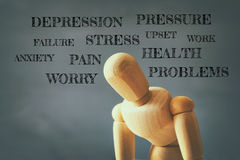 wooden dummy with worried stressed thoughts