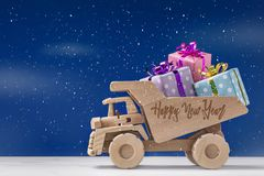 Wooden dump truck is toy with gifts.Happy Holidays. stock photos