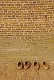 Wooden Dutch clogs outside of windmill house wall Royalty Free Stock Image