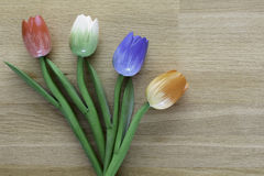 Wooden dutch tulips. Dutch tulips on a wooden background, an example of fine home decoration Royalty Free Stock Photo