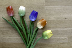 Wooden dutch tulips. Dutch tulips on a wooden background, an example of fine home decoration Stock Photos
