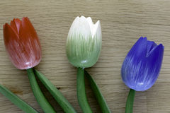 Wooden dutch tulips. Dutch tulips on a wooden background, an example of fine home decoration Stock Photography