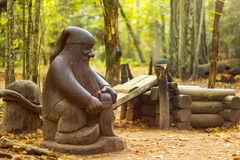Wooden Dwarf. Wooden statue of a dwarf in the forest Stock Image
