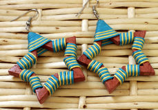 Wooden earrings in ethnic style Royalty Free Stock Photo
