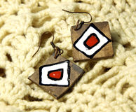 Wooden earrings in ethnic style Royalty Free Stock Photos