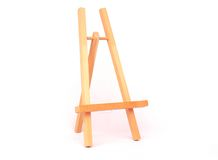 Wooden easel. A view of a sturdy wooden easel isolated against a white background Royalty Free Stock Images