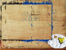 Wooden easel with art palette Royalty Free Stock Photo