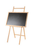 Wooden easel with a black board on white Stock Photos
