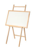 Wooden easel with a black board on white Royalty Free Stock Photography