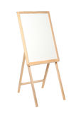 Wooden easel with a black board on white Stock Image