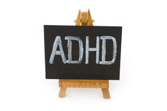 Wooden easel with blackboard with letters ADHD Stock Photography
