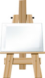 Easel. Wooden easel with blank canvas face directed towards the viewer Stock Photos