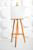 Wooden easel with blank canvas in the studio Stock Photo