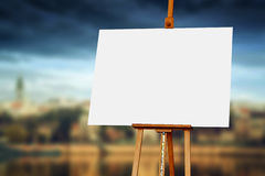 Wooden Easel with Blank Painting Canvas. As Copy Space for Mock Up Painting royalty free stock photo