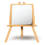 Wooden easel with blank paper. Canvas Royalty Free Stock Image