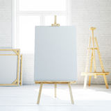 Wooden easel with blank white canvas in loft empty interior. 3d rendering Stock Image