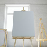 Wooden easel with blank white canvas in loft interior of art school or studio. 3d rendering. Wooden easel with blank white canvas in loft interior royalty free illustration