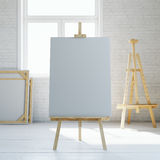 Wooden easel with blank white canvas in loft interior. 3d rendering Royalty Free Stock Photography