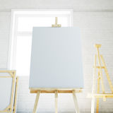 Wooden easel with blank white canvas in loft interior. 3d rendering Stock Photography