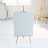 Wooden easel with blank white canvas in loft interior. 3d rendering Stock Images
