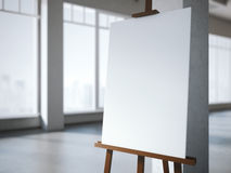 Wooden easel with a blank white canvas in modern interior. Royalty Free Stock Photos