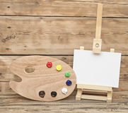 Wooden easel with clean paper Stock Images