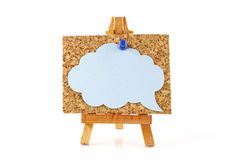 Wooden easel with corkboard and blue speech bubble Stock Image