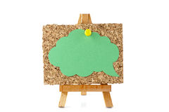 Wooden easel with corkboard and green speech bubble Royalty Free Stock Photos